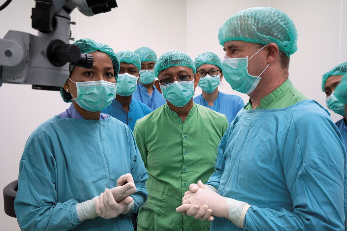 Prof Bill Morgan with young Indonesian surgeons
