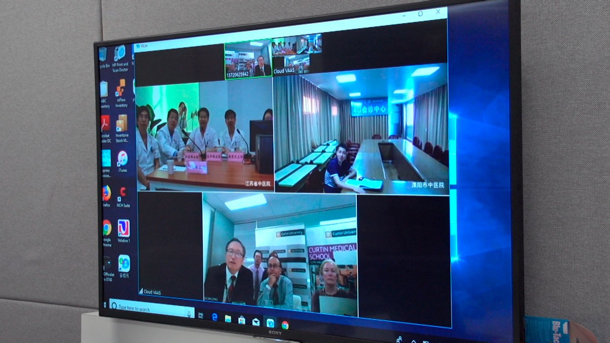 Dr Daniel Xu, Dr Joshua Dass & Dr Jill Orford teleconferencing with a team of specialists at a Jiangsu Province Hospital.