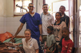 Team members with patient and family, post-operatively